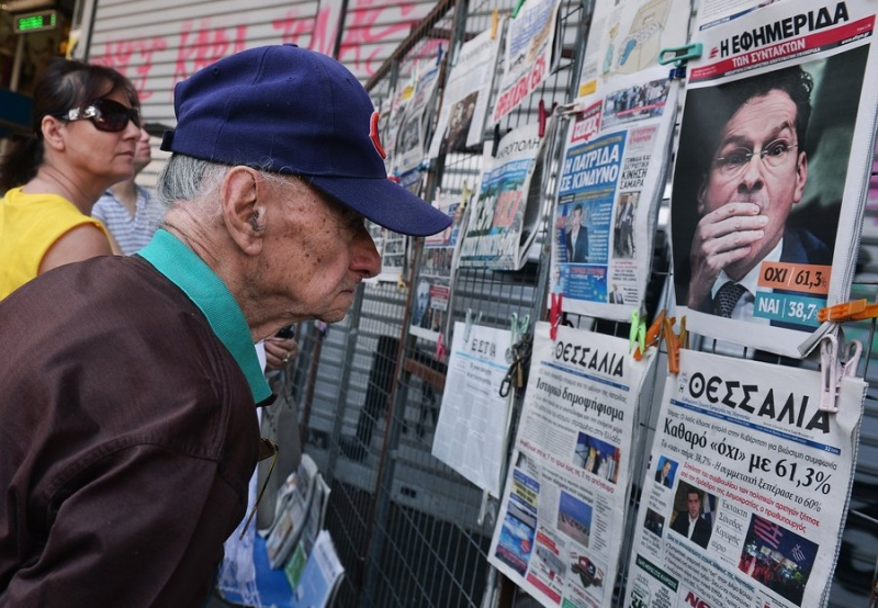 "Newspaper headlines show the results of Greece's referendum, in Athens, on July 6th. Photograph: Getty Images (via ""Irish Times"")"